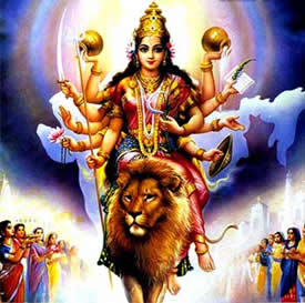Durga ma rides in triumph to the loving acclaim of Her children